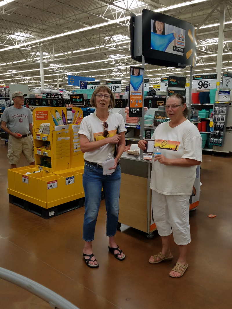 Club member and Asst. District Governor, Lyn Morgan and Sunrise Club President, Priscilla Scalf helping customers find supplies inside the store